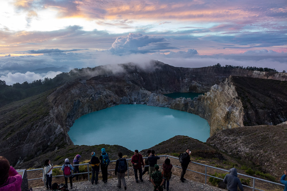 Crowds watch the sunrise at Kelimutu