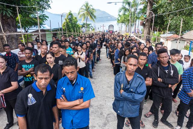 Queuing politely to worship in Larantuka