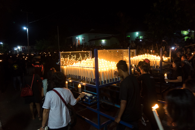 Ave Maria candles pass by