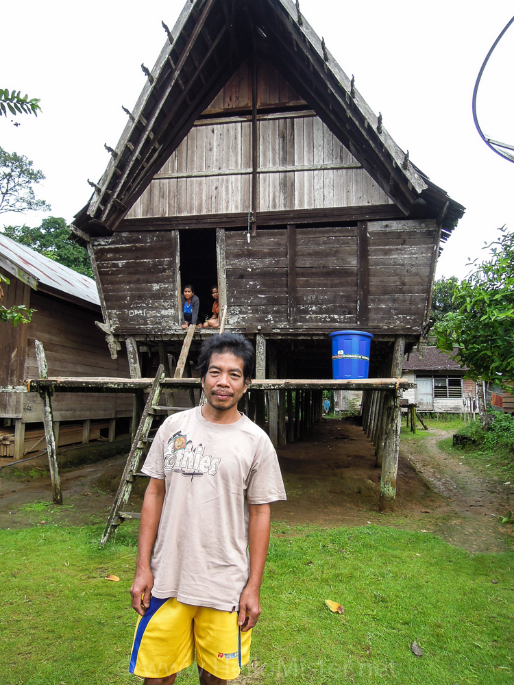 Long house and owner in Kudangan - see orangutan and meet dayak people in kalimantan