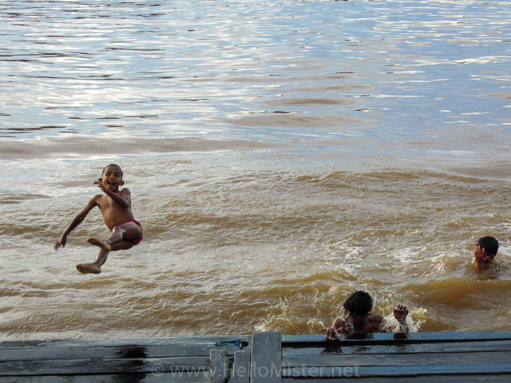 Boys play in the river in Kumai - see orangutan and meet dayak people in kalimantan
