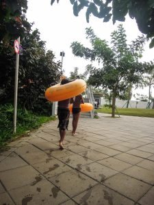 Carrying the tubes to the slides at Go Wet Waterpark Grand Wisata Bekasi