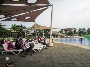 Sun loungers and shade awnings atGo Wet Waterpark Grand Wisata Bekasi