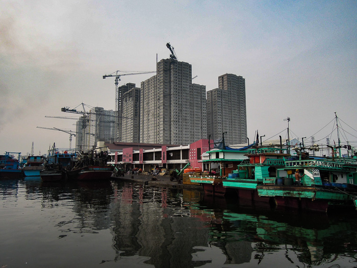 Fishing boats and sky scrapers - Ring of Fire An Indonesian Odyssey Book Review