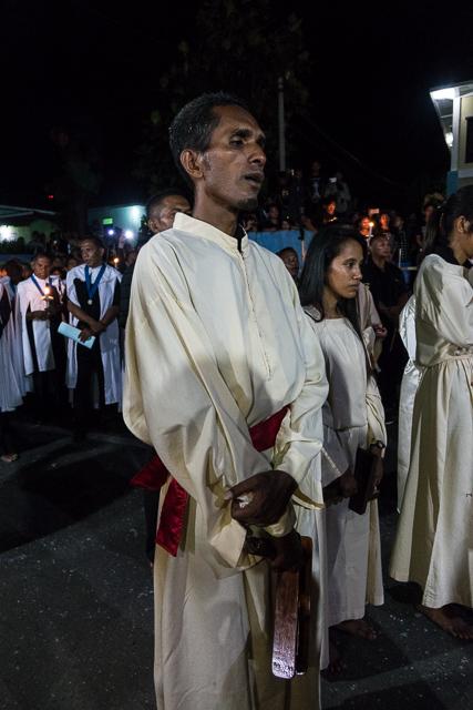 Swings a rattle - Holy Week procession in Larantuka