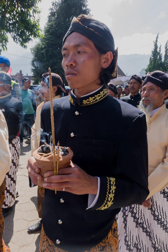 A man carries incense - Dieng Culture Festival