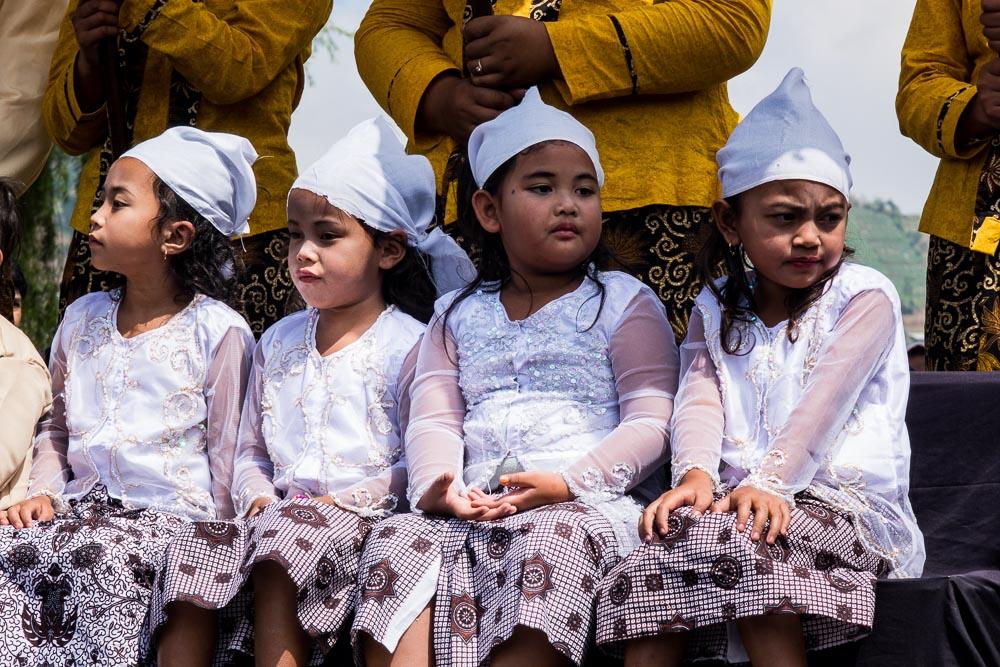 Nervous kids wait for blessings - Dieng Culture Festival