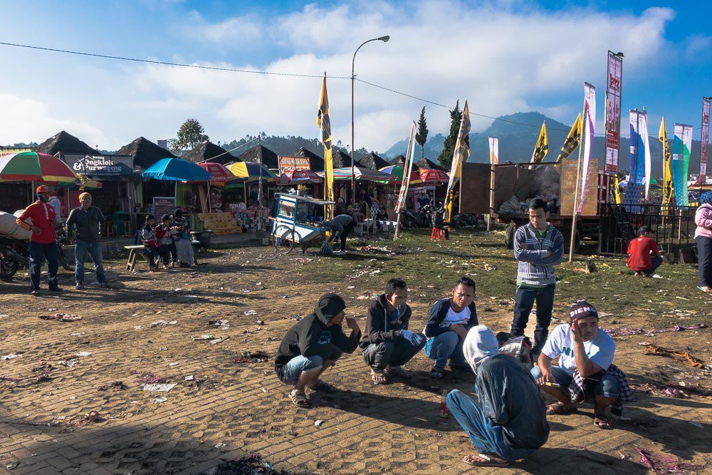 A group huddles in the cold morning - Dieng Culture Festival