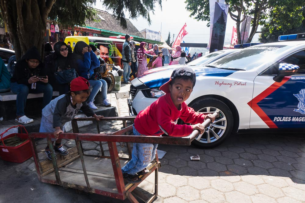 Boys go fast on the trolley - Dieng Culture Festival