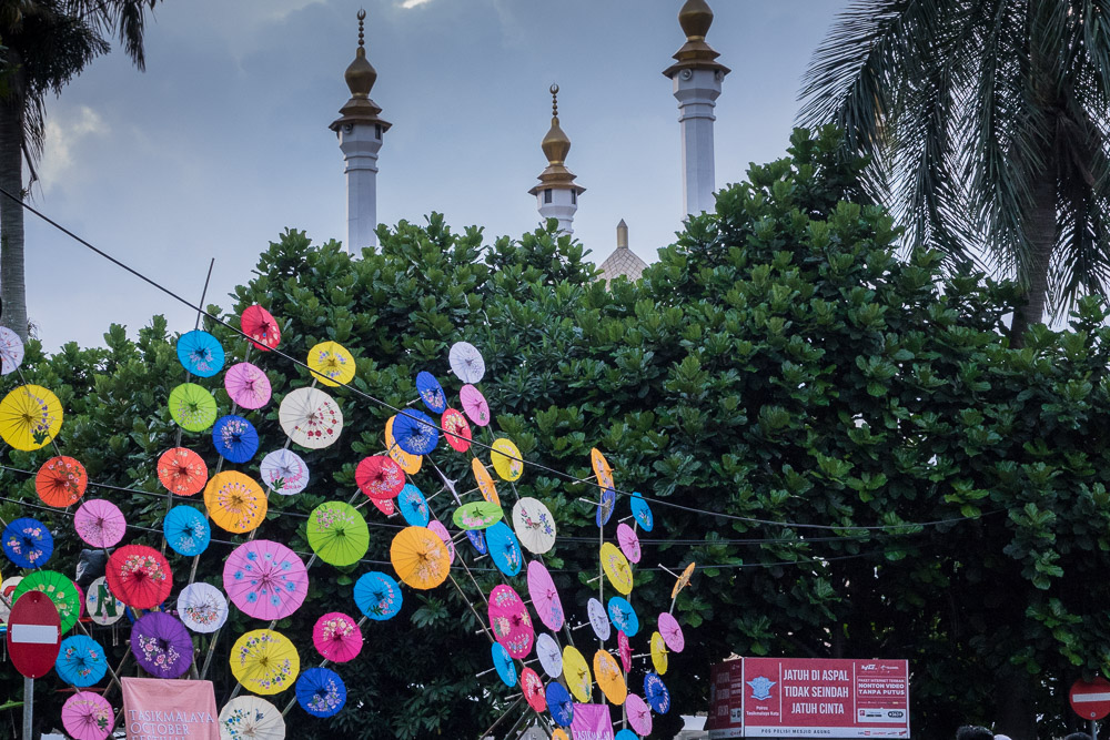 Colorful umbrellas in front of the mosque. - Tasikmalaya October Festival